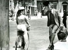 """Uncredited Disney actress rides a bike. Tommy Steele tips his hat — and sings """"Fortuosity."""""""