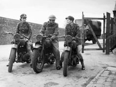 2 ATS (Auxiliary Territorial Service) trainee motorcycle despatch riders and a Royal Army Service Corps instructor at York, 23 May 1941.