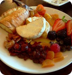 Warm Brie served with dried cranberries, dried apricot, seasonal preserves, raspberries, strawberries, nuts and warm bread :: Appetizer Ideas :: Cheese dishes :: from Firefly Restaurant