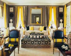 High contrast of yellow, black, and taupe living room designed by Mary McDonald