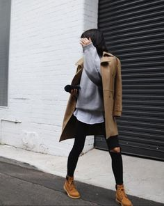 "norsis: ""Skinny black jeans, classic Timberland boots, grey sweater and a camel coat. The modern day classy wear """