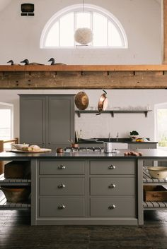 Soft Lead grey deVOL Shaker cupboards with chrome cup handles and back granite worktops