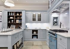 This stunning light blue kitchen features state of the art appliances. Both the cabinetry and beautiful island are painted in our very own Iris. Light Blue Kitchens, Grey Kitchens, Bespoke Kitchens, Kitchen Dresser, Kitchen Paint, Kitchen Cabinets, Black And Grey Kitchen, Building A House, Build House