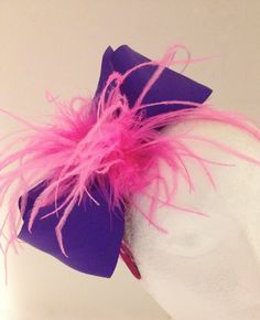A personal favorite from my Etsy shop https://www.etsy.com/listing/212808228/purple-and-hot-pink-feather-bow