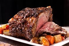 A prime rib recipe with a mustard and peppercorn coating to serve for a holiday or Christmas dinner.