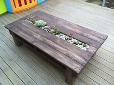 Wooden Pallet Table with planter in this photo, but I will do a trough for ice and wine/beer