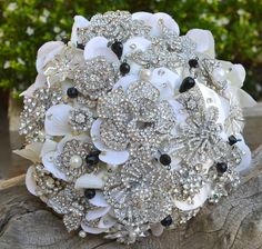 Deposit on a classic black and white brooch bouquet  by Noaki, $160.00