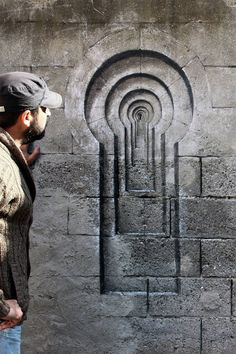 "Spanish street artist Pejac just stopped by Istanbul where he painted three new trompe-l'œil pieces in the district of Uskudar titled Lock, Poster and Shutters. Painted with brushes, acrylic paint, pencils and sandpaper the works are located very close together are intended to represent the ""perception and illusion of freedom."""