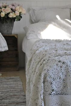 Old tablecloth at top layer of bedding... pretty!