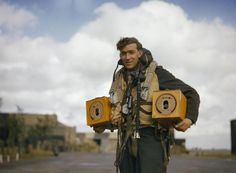 An RAF crewman displaying a pair of pigeons that were carried by Avro Lancanster bombers. The idea was that if the bomber crashed in German-occupied territory, the crew could release the pigeons. The pigeons would fly back to the home base to deliver a message about the crash. Before electricity and telegraph, homing pigeons were used as a sort of a mail service to deliver messages.