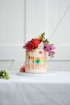 Textured buttercream cake with fresh florals and drip by LionHeart