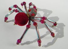 A fuzzy little cutie, with a velvet-flocked abdomen bead.