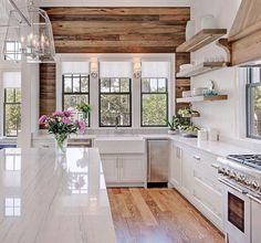 Mixing the natural element with those counters make it inviting.  Lanterns are the perfect size.