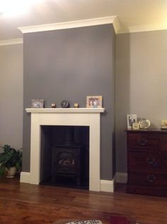 AFTER LOG BURNER FIRE COVERED WITH CHIMNEY BREAST / stove