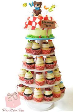 1st Birthday Teddy Bear Picnic Cupcake Tower | http://blog.pinkcakebox.com/1st-birthday-teddy-bear-picnic-cupcake-tower-2014-02-06.htm