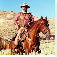 John Wayne- this is what a badass cowboy looks like