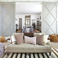Barn Doors are big in decorating right now. I love them! They hang on the outside of a door and slide on a track.