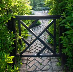 It's been said that fences make good neighbors and that is especially true when the fence is beautiful greenery set off by a Chippendale gate and a beautiful brick path.