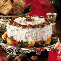 Fresh Orange Italian Cream Cake- This Italian cream cake recipe is enhanced with a pecan and cream cheese frosting and sweet, tangy orange curd between the cake layers. Garnish with glazed pecans and a boxwood garland to make it special for the holidays. Glazed Pecans, Spiced Pecans, Just Desserts, Dessert Recipes, Italian Desserts, Italian Cream Cakes, Italian Bakery, Bolo Cake, Candy