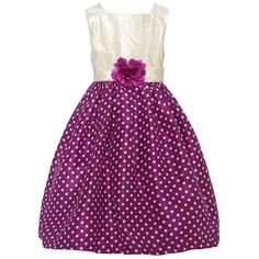 Trendy dress with a fitted bodice and a flared voluminous skirt from designer Mia Juliana. The dress has a sleeveless ivory bodice and a wine ivory polka dotted skirt. A cute fabric flower adorns the waist. Zips up at the back. Crinoline lining is firm an