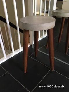 The seat is made out of concrete and the legs are reuse for another chair.
