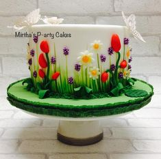 Every year I'm asked to donate a cake to be raffled, to help with funds for a well known asthma charity! This year I went for a spring theme! I thoroughly enjoyed creating this drum cake! Pretty Cakes, Cute Cakes, Beautiful Cakes, Amazing Cakes, Bolo Floral, Floral Cake, Fondant Cakes, Cupcake Cakes, Decors Pate A Sucre