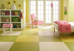 Linoleum also comes in large sheets that can be laid down as a solid color — or you can have a bit of fun with it. A pattern that's bold and bright and unique to your home is something that you'll only be able to achieve with a material like linoleum. Just don't try to do the installation yourself. Getting the cuts and seams just right will be worth the cost of bringing in some pros. - eclectic floors by Paul Anater