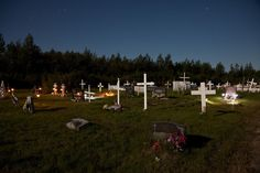 Moosonee public cemetery by moonlight.