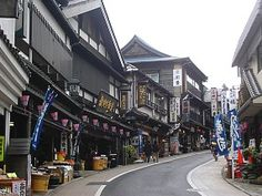 Narita Japan....one of our layover cities when we fly into Japan...part of the fun in visiting Naritasan is the colorful store lined streets stretching over one kilometer selling traditional crafts, foods and souvenirs.  This street leads to the Shotoku Taishi Hall where you are able to visit a broad variety of temple buildings..