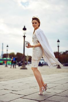 Kristina Bazan of Kayture wears an ELIE SAAB dress and shoes, CHLOE coat, and ANYA HINDMARCH bag. (October 8, 2014)