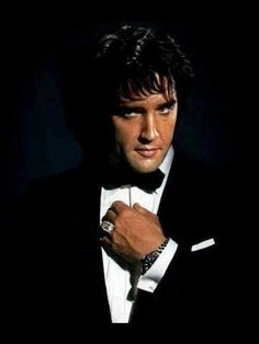 Rare photo of Elvis dressed to the 9's in a beautiful tuxedo and elegant ring.