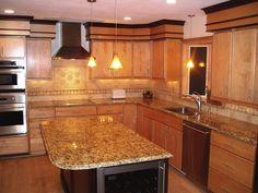 Image result for granite countertop colors honey cabinets black crown moulding