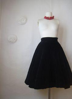 Vintage 1950s black velvet quilted circle skirt.