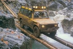SCARY FOUR WHEELER INCHING OVER NARROW LOG BRIDGE OVER RAGING CHASM - SCARY! - WHAT COULD GO WRONG?