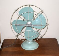 WESTINGHOUSE A010-1 Mid Century Art Deco Style Oscillating Desk Fan / Turquoise / One Speed / Works / All Original / Free US Shipping. $225.00, via Etsy.