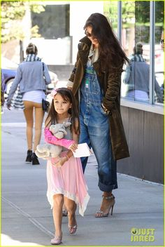 Katie Holmes takes her daughter Suri to a nail salon on September 22, 2013