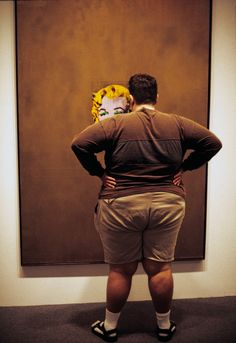 "Magnum Photos - Thomas Hoepker - USA. New York City. 2005. Museum of Modern Art. Fat man in front of Andy Warhol's ""Gold Marilyn."""