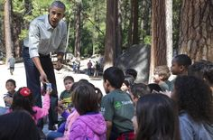 """President Barack Obama hands out tickets for entry to the National Parks to children attending the """"Every Kid in a Park"""" event at Yosemite National Park on Saturday, June 18, 2016."""