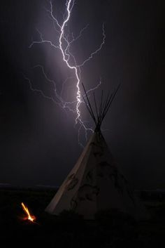 Amazing shot of the lightning and teepee. I have often thought about how the Native Americans dealt with the weather that we in the plains deal with in our basements, and houses. Ride The Lightning, Thunder And Lightning, Lightning Strikes, Lightning Storms, Lightning Photos, Lightning Electric, Native American History, American Indians, Fuerza Natural