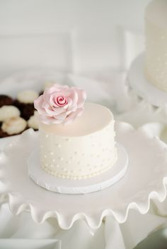 mini white wedding cake by cakes by rumy http://www.weddingchicks.com/2013/10/04/beach-wedding-in-pink-and-white/