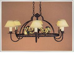 "8088-38-OVAL  SIX LIGHT IRON CHANDELIER  SIX HAND POUNDED PUFFY BRASS FARM ANIMALS: OTHER ANIMALS AVAILABLE FINISH SHOWN: INDIAN SUMMER ANIMALS: ANTIQUE BRASS SHADE: 3X7X4  WITH WHITE WAX CANDLE MAXIMUM WATTAGE: 360 CANDELABRA BASE SOCKETS HT 18"" W 38"" D 29"" THIS FIXTURE IS HUNG WITH TWO CHAINS"