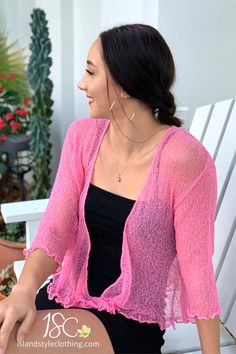 Super cute summery light-weight cardigan in a stunning Pink Fairy Floss Color. Perfect to throw over a summer dress, bikinis, jeans, shorts, and more! You can roll this up in your bag and pop on after the sun goes down. #casual #fashion #luau #cruisewear #summer #beachcoverup #bolero #cruisewear #beachcardigan #cardigan #over-swim #knit #knittedshrug #shrug #lightweight