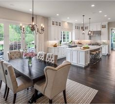 Beautiful kitchen! Love the chairs, dark vs white woods, everything.
