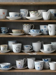 Cabinet full of Royal Copenhagen Cups & Mugs in the 2013 Catalogue.