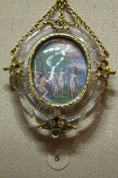 Very unusual renaissance pendant with a miniature depicting  the kidnapping of Helene by Paris, framed in sculpted rock crystal with enameled gold appliques. c. 1592 of Spanish origin.