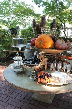 The last several Thanksgiving holidays the weather in Florida as been such that I have enjoyed very much an outdoor affair. How do you plan to serve Thanksgiving dinner this year?  This image is from the Mary Carol Garrity Fall Open Home Tour. I love the way she used a small wheel barrow pm the table to coral her fall decorations.