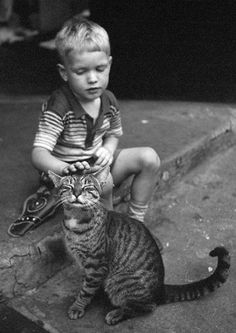 Boy and his very content kitty cat. 1954, New York, NY. Vivian Maier