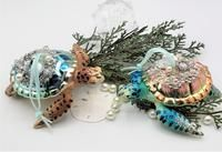 Our nautical glass turtle ornament is painted in such intricate detail, then his shell is all bliged out in tasteful crystals, rhinestones, and pearls for Christmas. The painting of the facial features and details of his fins are simply amazing