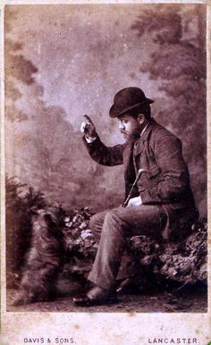 Cabinet card of a Terrier learning tricks.