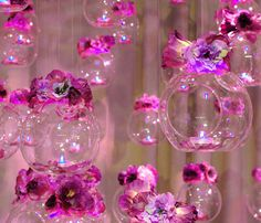 Hanging votive orbs with themed flowers
